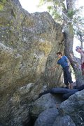 Rock Climbing Photo: Tucker eyes up the holds on The Warm Up Boulder.