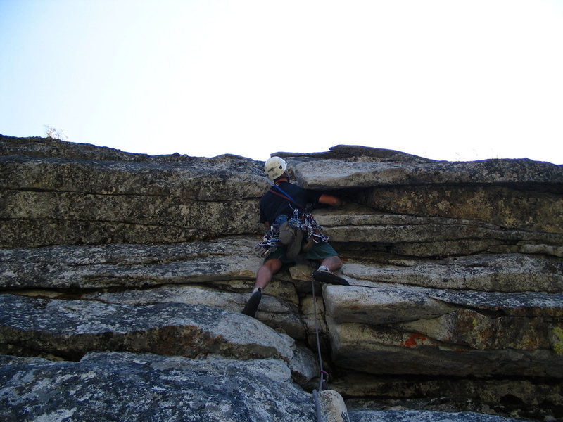 Rock Climbing Photo: The summit overhangs.  An excellent finish to an e...