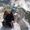 Anne enjoying the spectacular summit and the rewarding view atop Cathedral peak.