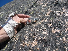 Rock Climbing Photo: An underdrilled buttonhead partway up the Beckey b...