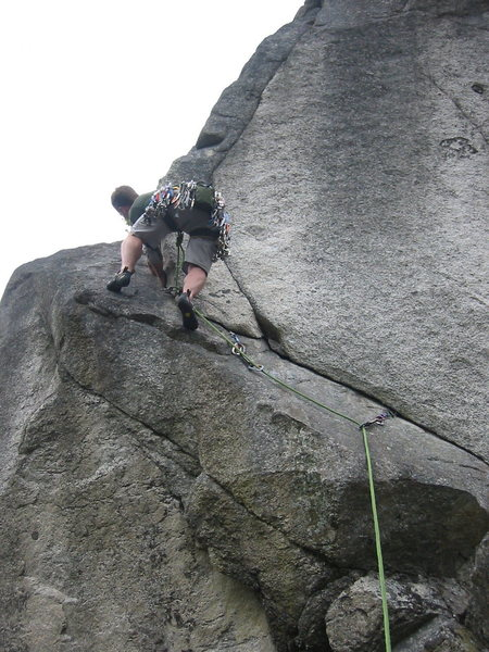 Brad starting up Supervalue.  The rope ended up snagging in the crack between his second and third piece.  I was able to scramble up and remove his first piece which prevented it from happening again, so you may wish to backclean a bit on this pitch.
