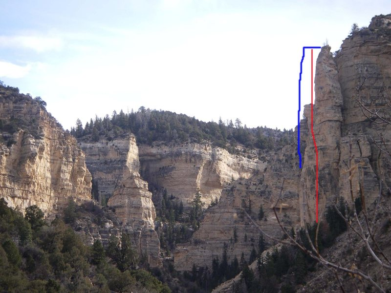 The blue line indicates what the tower used look like. The red line is the line of 1st ascent on the tower.