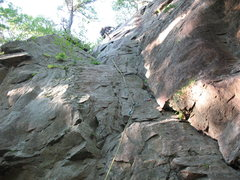 Rock Climbing Photo: John K topping out on Penitent Crack.