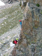 Rock Climbing Photo: Two climbers nearing the summit ridge on the Petit...