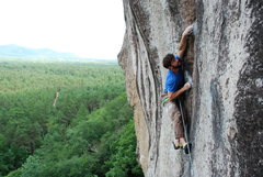 Rock Climbing Photo: Conway starting the runout crux.