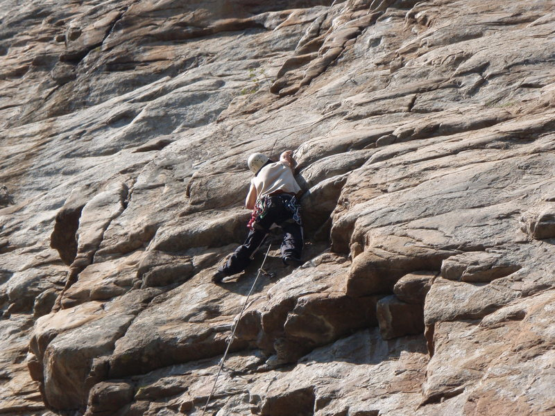 Johnston working through the overhanging slopey jugs on Timorus.
