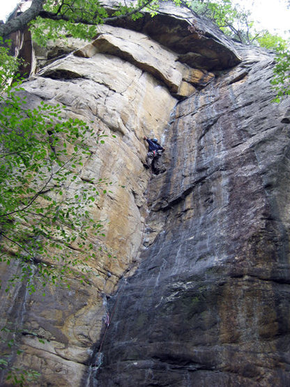 Chris approaches the crux. Black and Tan, Endless Wall, New River Gorge.