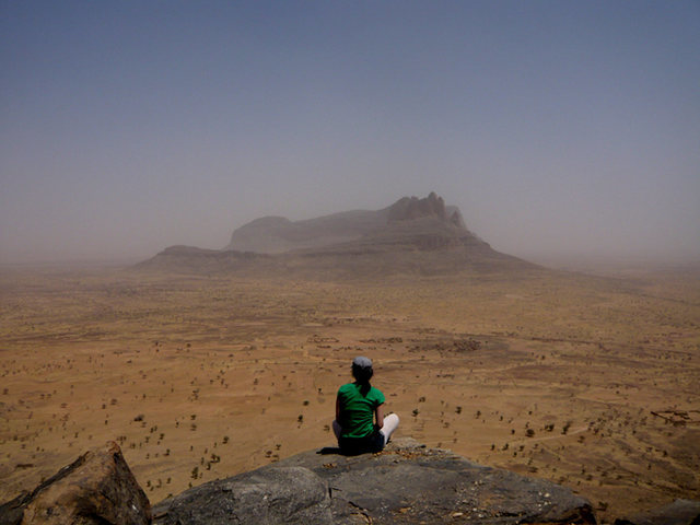 Sitting atop a part of the sandstone fortress that is the Hand of Fatima looking out on the Sahel.  It was the best trip of my life.  Please visit Mali...you'll never forget it.