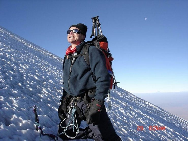 Greeting the sun at about 17,000 ft on Pico Orizaba (Jan 2005). Note the moon in upper right quadrant.