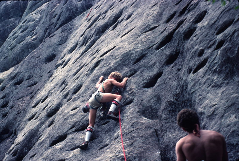 On the first pitch of Nick Danger 5.10, on the Sun Wall. Belayed by Scott McCook. <br> Photo by Jim Walker<br> 1984