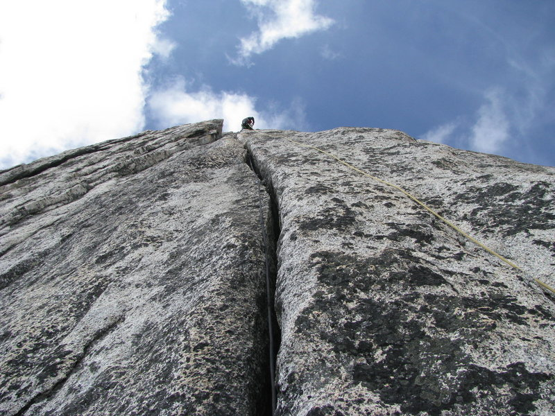 Rock Climbing Photo: 5.10+ offwidth pitch 6. Photo By: Dave Sorric