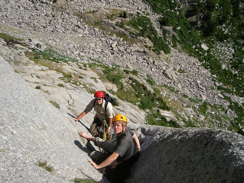 Tight belay spot at the top of pitch 2 .