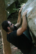 Rock Climbing Photo: jakob pulling down hard on boulder x...