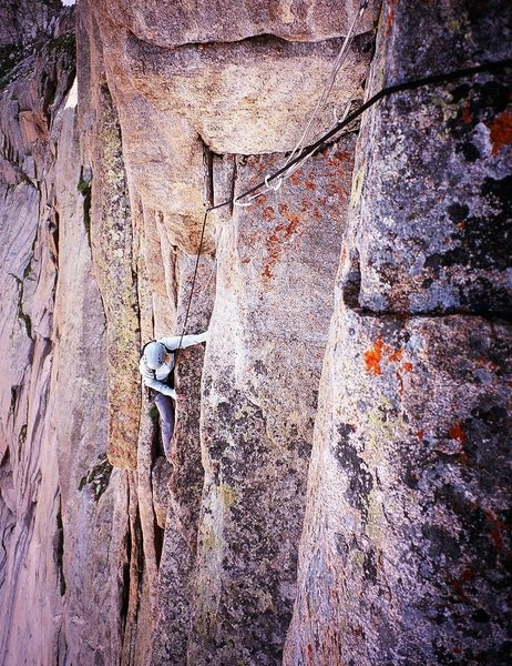 """Kat A. approaches the sandbagged """"10a"""" crux on the Red Wall. Photo by Tony Bubb, 7/08."""