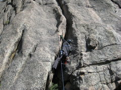 Rock Climbing Photo: Lumpy Ridge offwidth - Optional P4 of White Whale.
