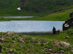 Rock Climbing Photo: a man fishing with some goats by his side