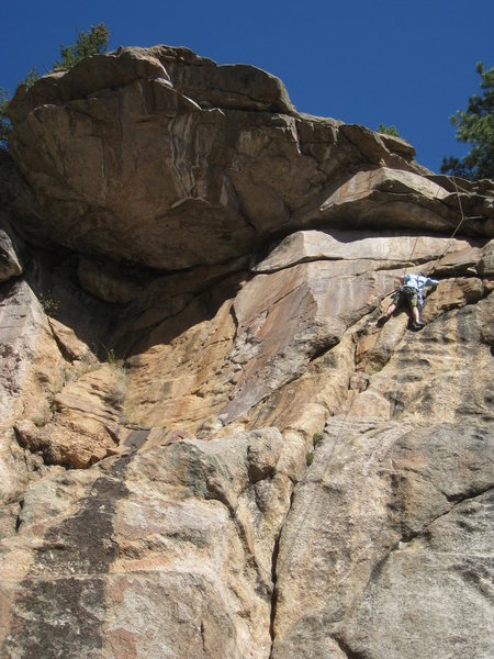 Katrina is about to leave the finger crack and tackle the crux.
