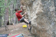 Rock Climbing Photo: Chase Gardner setting up for the first move