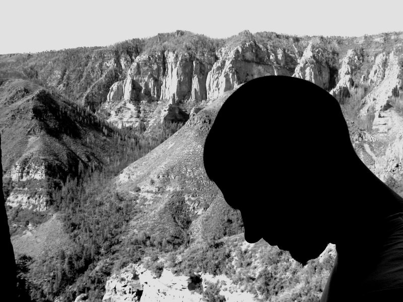 Mug profile of Wade Forrest on the Labor Day belay ledge, waterfall area, overlooking part of Oak Creek Canyon