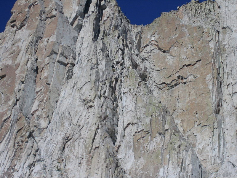 Erik Kelly, visible near the bottom right, enters the crux.