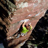 Sticking the crux move on The End. September '08. Photo by Isaiah@ de Therneau.