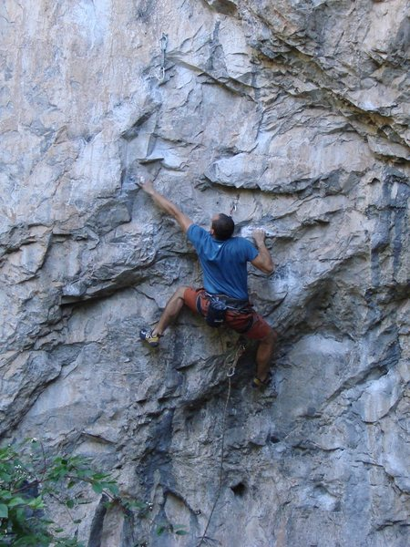 Chris K. sticking the reachy lower crux move.