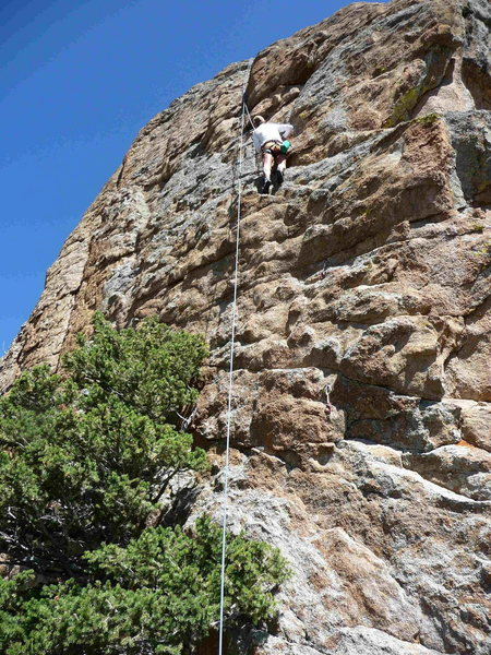 Cindy Martinson top-roping up Byrontosaurus, just above the crux.