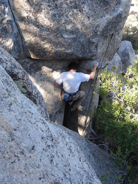 Tom Donnelly emerging from the crack to begin the crux sequence.