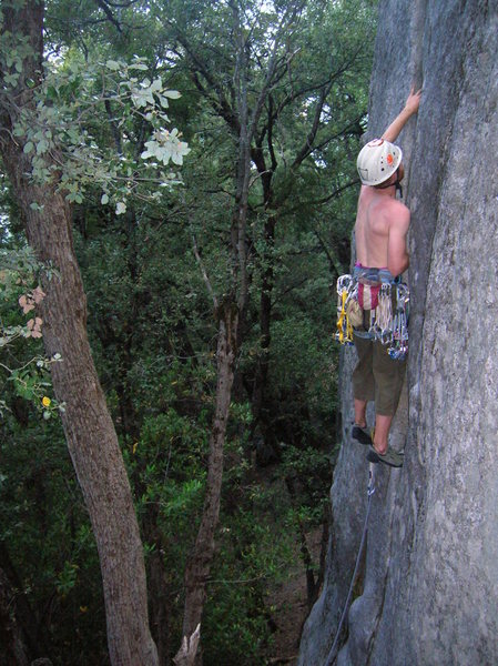 Pulling the crux early on, merely 10 feet off the ground.