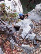 Rock Climbing Photo: Joe deciphers the tricky exit move on P1.