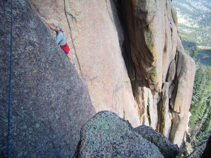 Mike traversing over to the start of a central crack system we were aiming for in the South Platte.  A VFA, direct and up the center of the main buttress.  5.10- R