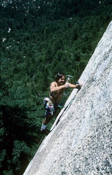 Drilling the final bolt on the first ascent.  Climber: Darrell Hensel.  Photo: Kevin Powell.