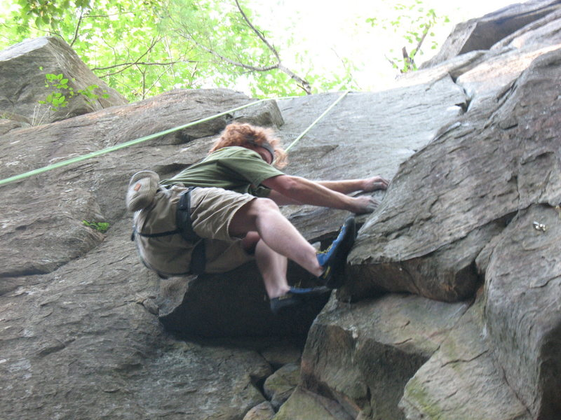 Chris pulling through the second overhang into the layback section