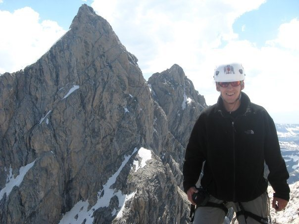 Bojan Mitkovski on the summit of Mt. Owen. The North Ridge of Grand Teton is in the background.