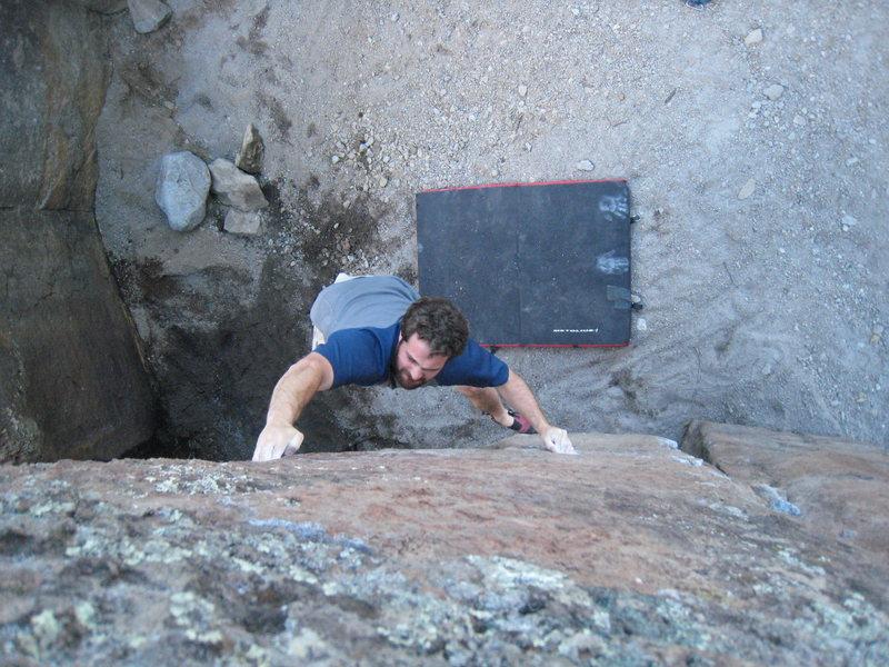 Brian sticking the crux move on <em>PFVP.</em> Sept. 17, 2008.