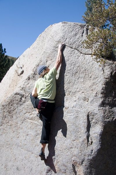 Making the crux moves to the right hand slot.