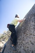 Rock Climbing Photo: Moving through the crux to the top.