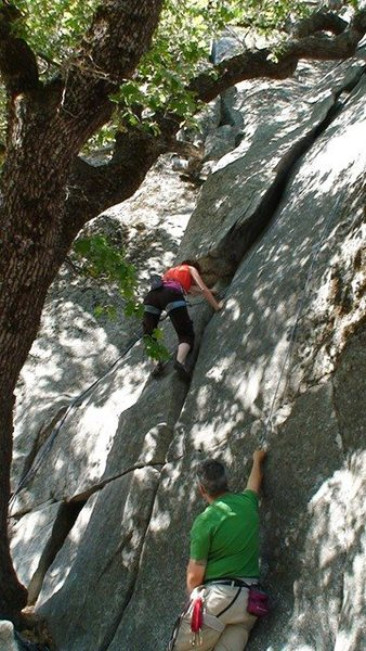 Andrea climbing the route