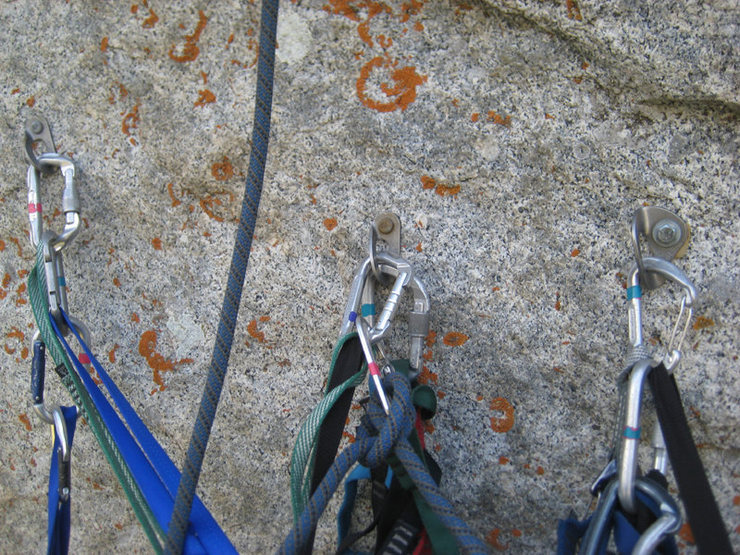 The hanging belay at the top of pitch 3. Two older bolts and one new one.