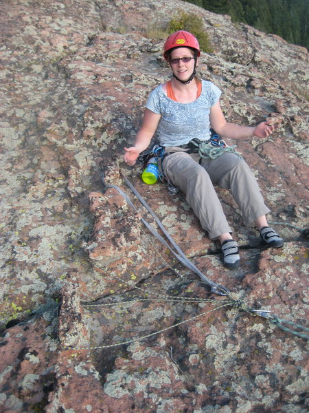 Alyce Smith examines my handy Chicken Head Anchor on the FA of Tradventure (5.9) in Devils Head, CO.