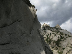 Rock Climbing Photo: Lance topping out on the first free ascent of pitc...
