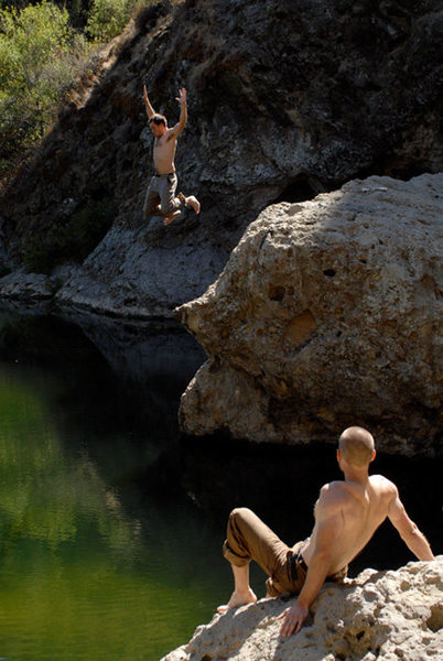 Jeese Groves (jumping) and Andy Patterson escape the heat on a scorching September afternoon in Malibu Creek State Park.