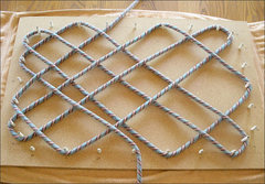 Rock Climbing Photo: Start weaving the rope around the appropriate pegs...