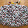 A quadruple-weave rug we made from retired 10.2mm x 60m climbing rope.  Dimensions are 2 1/3' x 1 3/4'.