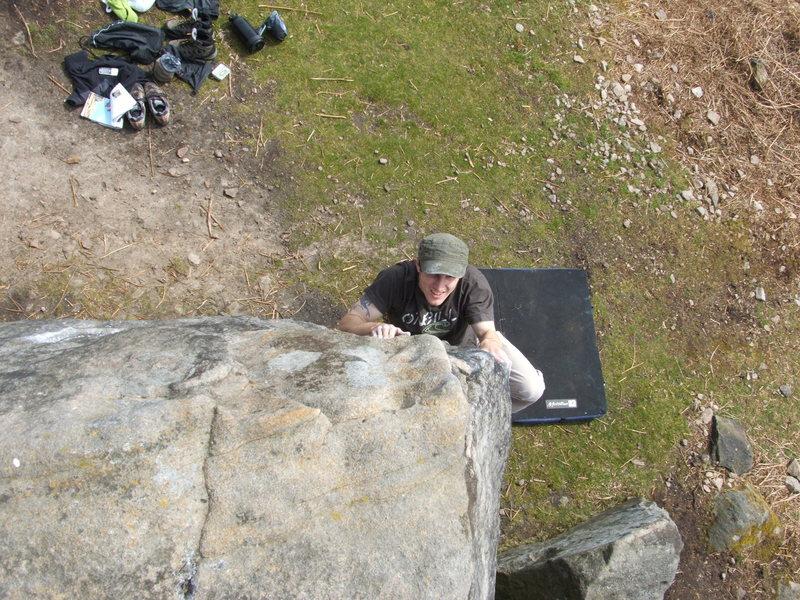 Me bouldering at Curbar Peak District.