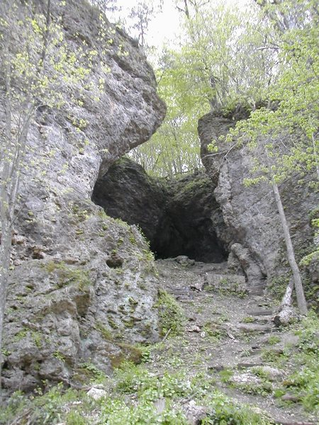 View into the Comic Gallery at Pictured Rocks. Flash follows the overhanging arete to the left. Schoolio is on the right, and Tazmanian Devil is on the back wall.