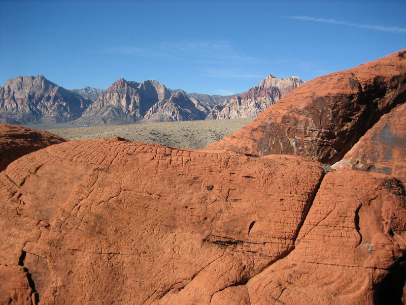 The top of Sweet Pain (middle right) in front of Red Rock Canyon