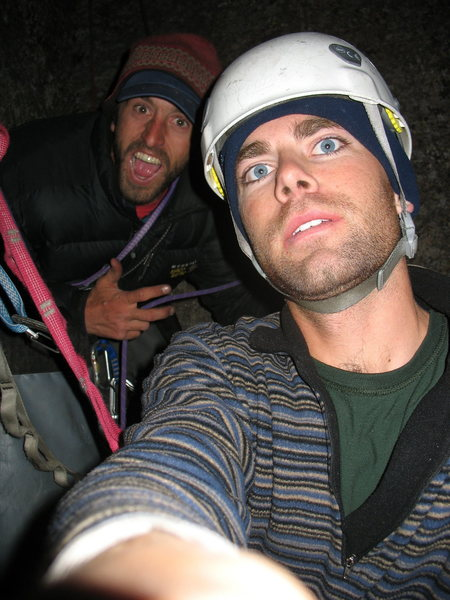 Pat and Trevor still strapped to the belay at 9pm while Dave finishes cleaning the pitch. Three guys, no headlamps...