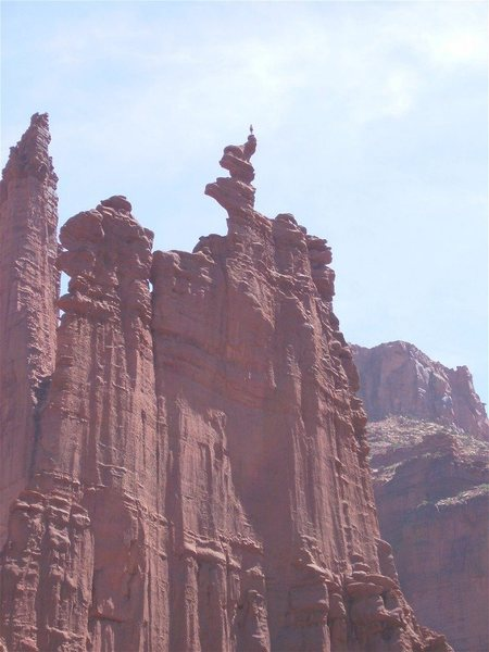 Climber on summit of Ancient Art, as seen from the trail bottom.