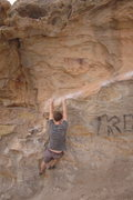 Rock Climbing Photo: Getting into position.  Hueco at the top of the ph...